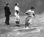 FILE - In this Oct. 5, 1938 file photo, New York Yankees' Lou Gehrig scores the first run of the 1938 World Series against the Chicago Cubs as he crosses home plate in the second inning of Game 1 at Wrigley Field in Chicago.  (AP Photo/File)