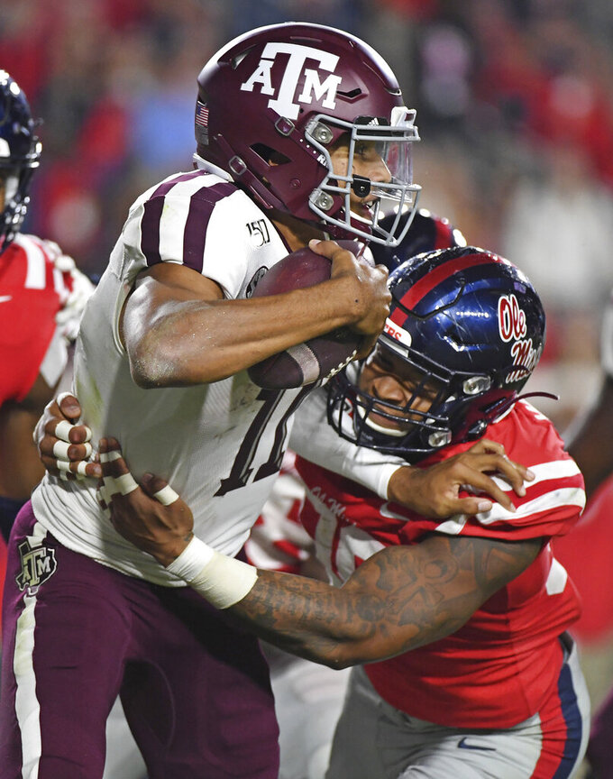 Mississippi linebacker Charles Wiley (99) tackles Texas A&M quarterback Kellen Mond (11) during the first half of an NCAA college football game in Oxford, Miss., Saturday, Oct. 19, 2019. (AP Photo/Thomas Graning)