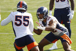 Denver Broncos linebacker Bradley Chubb, left, takes part in a drill with linebacker Justin Hollins at the team's NFL football training camp Friday, Aug. 14, 2020, in Englewood, Colo. (AP Photo/David Zalubowski)
