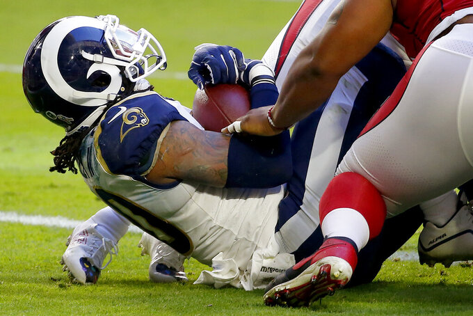 Los Angeles Rams running back Todd Gurley falls into the end zone for a touchdown against the Arizona Cardinals during the first half of an NFL football game, Sunday, Dec. 1, 2019, in Glendale, Ariz. (AP Photo/Ross D. Franklin)