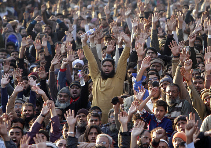 Supporters of the Pakistan Defense Council, an alliance of hardline Islamist religious parties chant slogans during a rally against America, in Lahore, Pakistan, Sunday, Dec. 17, 2017. Thousands of supporters of hardline Islamist religious parties have rallied condemning U.S. President Donald Trump for declaring Jerusalem as Israel's capital. (AP Photo/K.M. Chaudary)