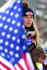 "FILE - In this Dec. 29, 2019, file photo, first placed United States' Mikaela Shiffrin celebrates on the podium after completing a women's World Cup slalom ski race in Lienz, Austria. The Associated Press spoke to more than two dozen athletes from around the globe -- representing seven countries and 11 sports -- to get a sense of how concerned or confident they are about resuming competition. ""If the tests don't come back for a couple of days and what-not, how does that really work?"" said ski racer Mikaela Shiffrin, a two-time Olympic gold medalist and three-time World Cup overall champion. ""It's good to know if you test positive or negative. But if we're talking about being tested today so we can race tomorrow, but the results don't come back for two days, it doesn't really help."" (AP Photo/Pier Marco Tacca, File)"