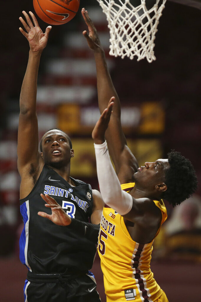 Saint Louis' Javonte Perkins (3) shoots the ball against Minnesota's Isaiah Ihnen (35) during an NCAA college basketball game, Sunday, Dec. 20, 2020, in Minneapolis. Minnesota won 90-82. (AP Photo/Stacy Bengs)