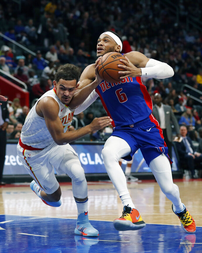 Detroit Pistons guard Bruce Brown (6) drives on Atlanta Hawks guard Trae Young during the first half of an NBA basketball game Friday, Nov. 22, 2019, in Detroit. (AP Photo/Carlos Osorio)