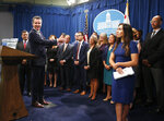California Gov. Gavin Newsom, second from left, gestures towards a group of immigrant advocates and service providers as he discusses the effects of the Trump administration's new rules blocking green cards for many immigrants who receive government assistance, during a news conference in Sacramento, Calif., Friday, Aug. 16, 2019. Newsom and Attorney General Xavier Becerra, left, announced that California has joined three other states and the District of Columbia in a lawsuit filed Friday against some of the administration's most aggressive moves to restrict legal immigration that are supposed to take effect in October. (AP Photo/Rich Pedroncelli)