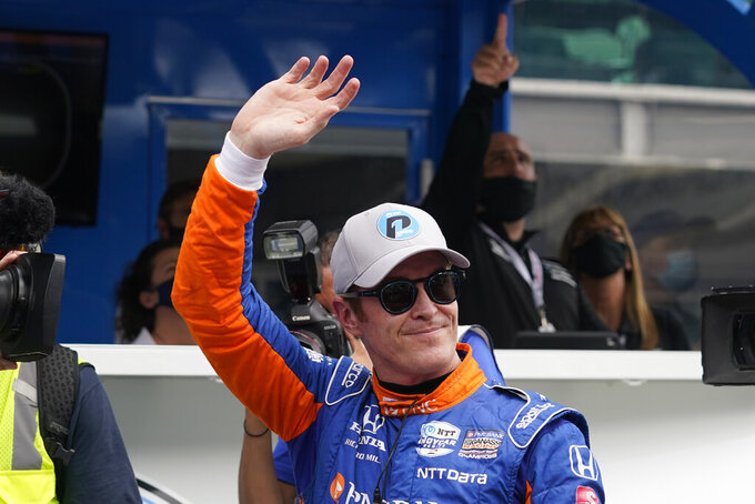 Scott Dixon, of New Zealand, waves to fans after winning the pole for the Indianapolis 500 auto race at Indianapolis Motor Speedway, Sunday, May 23, 2021, in Indianapolis. (AP Photo/Darron Cummings)