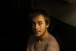 Sam Ware, 22, sits for a photo in his mother's home, in Fountaindale, Central Coast, Australia, Friday, July 19, 2019. The instructions following his wisdom tooth surgery stated that he should take two opioid painkillers for his pain that night. He took four. Sam loved the buzz they'd given him. The codeine had made him feel safe and warm, like being tucked into a cozy bed on a cold winter's night. He wanted more. (AP Photo/David Goldman)