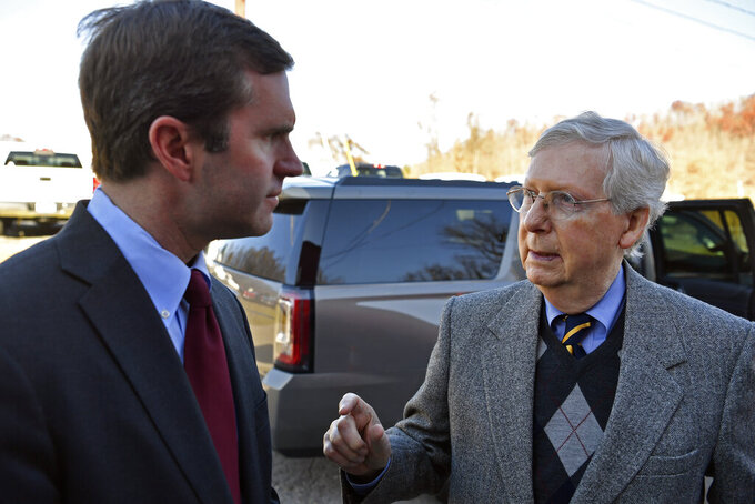 FILE - In this Monday, Nov. 25, 2019, file photo, Senate Majority Leader Mitch McConnell, R-Ky., right, speaks with then-Gov.-Elect Andy Beshear before the dedication of a Recovery Community Center in Manchester, Ky. Kentucky's Democratic Gov. Beshear vetoed legislation Monday, March 22, 2021, that would empower Republican leaders to influence his choice to temporarily fill a U.S. Senate seat should a vacancy occur. (AP Photo/Timothy D. Easley, File)