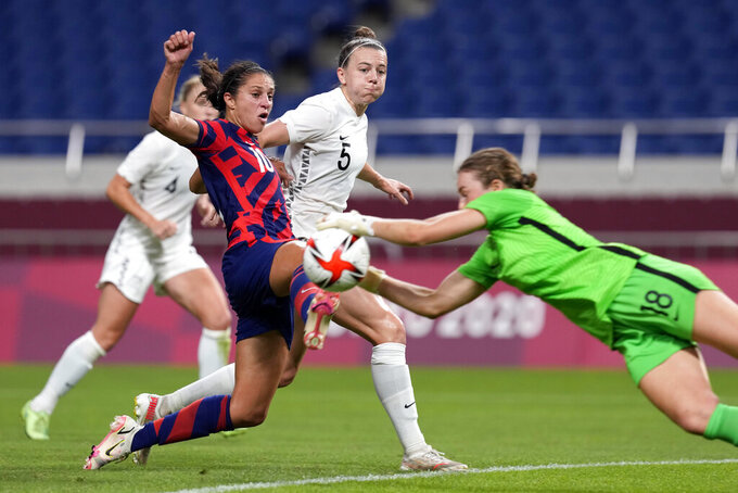 New Zealand's goalkeeper Anna Leat (18) makes a save against United States' Carli Lloyd (10) during a women's soccer match at the 2020 Summer Olympics, Saturday, July 24, 2021, in Saitama, Japan. (AP Photo/Martin Mejia)