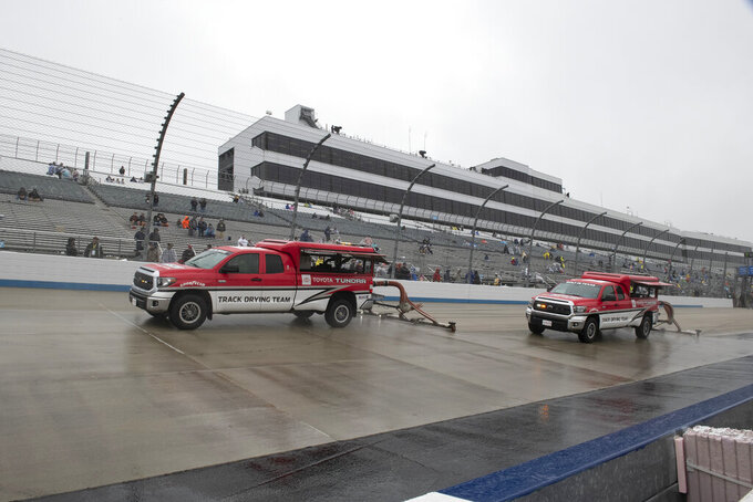 Track drying team works to dry the track before the start of a NASCAR Cup series auto race Sunday, May 5, 2019, at Dover International Speedway in Dover, Del. (AP Photo/Jason Minto)