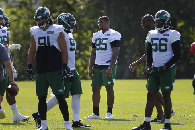 New York Jets' Quinnen Williams (95), center, looks on while others participate in a practice at the NFL football team's training camp in Florham Park, N.J., Friday, July 26, 2019. (AP Photo/Seth Wenig)