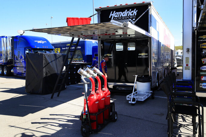 A crew member for JTG Daugherty Racing enters a back up hauler from Hendrick Motorsports during practice for a NASCAR Cup Series auto race at Kansas Speedway in Kansas City, Kan., Friday, Oct. 18, 2019. The JTG race team had to switch haulers after an accident on the way to Kansas Speedway rendered their hauler unusable. (AP Photo/Orlin Wagner)
