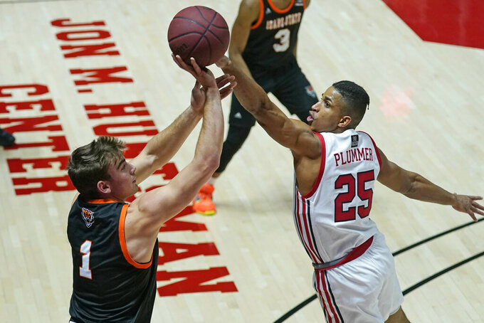 Utah guard Alfonso Plummer (25) defends against Idaho State guard Liam Sorensen (1) during the first half of an NCAA college basketball game Tuesday, Dec. 8, 2020, in Salt Lake City. (AP Photo/Rick Bowmer)