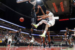 Hawaii guard Drew Buggs, right, passes around Long Beach State guard Deishuan Booker (15) and guard Jordan Roberts during first half of an NCAA college basketball game at the Big West men's tournament in Anaheim, Calif., Thursday, March 14, 2019. (AP Photo/Chris Carlson)