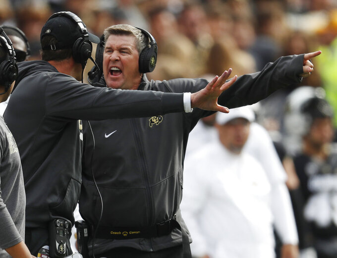 Colorado head coach Mike MacIntyre, back, yells at defensive coordinator D.J. Eliot in the first half of an NCAA college football game against Arizona State Saturday, Oct. 6, 2018, in Boulder, Colo. (AP Photo/David Zalubowski)