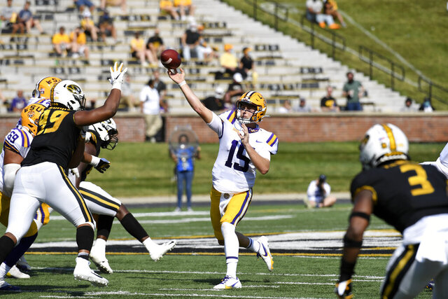 LSU quarterback Myles Brennan throws during the first half of an NCAA college football game against Missouri Saturday, Oct. 10, 2020, in Columbia, Mo. (AP Photo/L.G. Patterson)