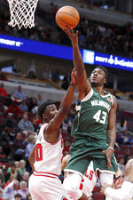 Milwaukee Bucks' Thanasis Antetokounmpo (43) shoots over Chicago Bulls' Adam Mokoka during the second half of an NBA preseason basketball game Monday, Oct. 7, 2019, in Chicago. (AP Photo/Charles Rex Arbogast)