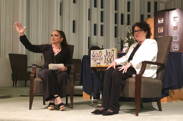 In this Tuesday, Jan. 28, 2020 photo, Singer Gloria Estefan moderates a presentation with Supreme Court Justice Sonia Sotomayor in Miami. Sotomayor spoke to a crowd about her new book