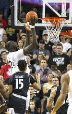 Central Florida center Tacko Fall (24) shoots over Cincinnati guard Cane Broome (15) during the first half of an NCAA college basketball game, Thursday, March 7, 2019, in Orlando, Fla. (AP Photo/Willie J. Allen Jr.)