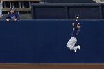 Tampa Bay Rays center fielder Kevin Kiermaier makes a leaping catch on a fly ball by Houston Astros Alex Bregman during the first inning in Game 3 of a baseball American League Championship Series, Tuesday, Oct. 13, 2020, in San Diego. (AP Photo/Gregory Bull)