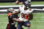 Chicago Bears tight end Demetrius Harris (86) runs against Atlanta Falcons defensive back Darqueze Dennard (34) during the second half of an NFL football game, Sunday, Sept. 27, 2020, in Atlanta. The Chicago Bears won 30-26. (AP Photo/John Bazemore)