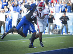Georgia running back D'Andre Swift (7) rushes for a touchdown during the first half an NCAA college football game against Kentucky in Lexington, Ky., Saturday, Nov. 3, 2018. (AP Photo/Bryan Woolston)