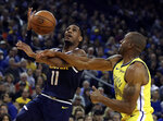 Denver Nuggets' Monte Morris, left, shoots against Golden State Warriors' Andre Iguodala during the first half of an NBA basketball game Friday, March 8, 2019, in Oakland, Calif. (AP Photo/Ben Margot)