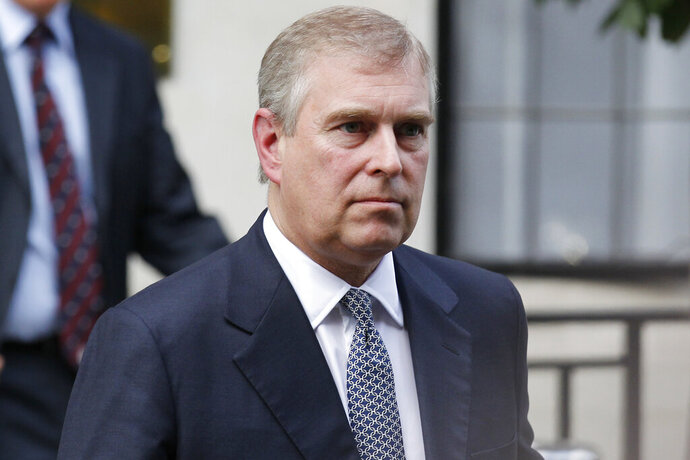 FILE- In this June 6, 2012 file photo, Britain's Prince Andrew leaves King Edward VII hospital in London after visiting his father Prince Philip.  Prince Andrew says in a BBC interview scheduled to be broadcast Saturday, Nov. 16, 2019, that he doesn't remember a woman who has accused him of sexually exploiting her in encounters arranged by Jeffrey Epstein. Andrew has made similar denials for years but has come under new pressure following Epstein's arrest and suicide last summer. (AP Photo/Sang Tan, File)