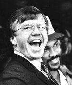 FILE - In this Feb. 2, 1983, file photo, Washington Redskins head coach Joe Gibbs, left, and player Fred Dean react to the huge crowd that turned out to honor their victory over the Miami Dolphins in the Super Bowl, in Washington. Gibbs restored a winning culture to the Washington franchise, leading the Redskins to three Super Bowl appearances in the 1980s, including two victories. He'd win another in 1991. (AP Photo/File)