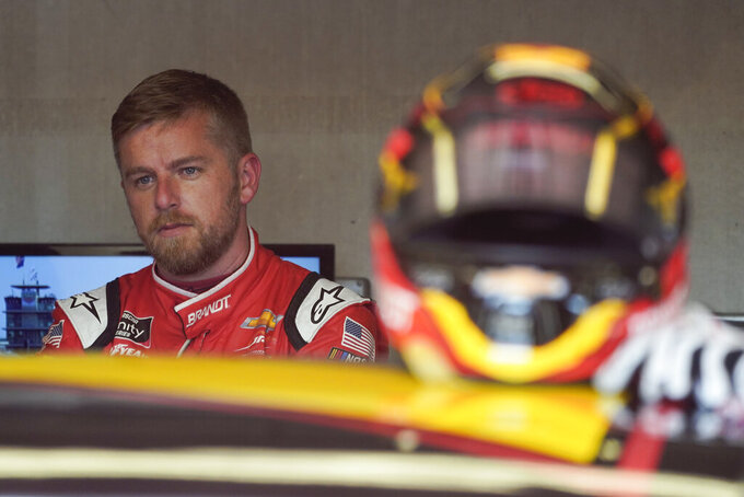 Justin Allgaier waits in the garage before practice for the NASCAR Xfinity Series auto race at Indianapolis Motor Speedway, Friday, Aug. 13, 2021, in Indianapolis. (AP Photo/Darron Cummings)