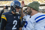 Indianapolis Colts quarterback Brian Hoyer, right, greets Pittsburgh Steelers quarterback Mason Rudolph, left, after an NFL football game, Sunday, Nov. 3, 2019, in Pittsburgh. (AP Photo/Don Wright)