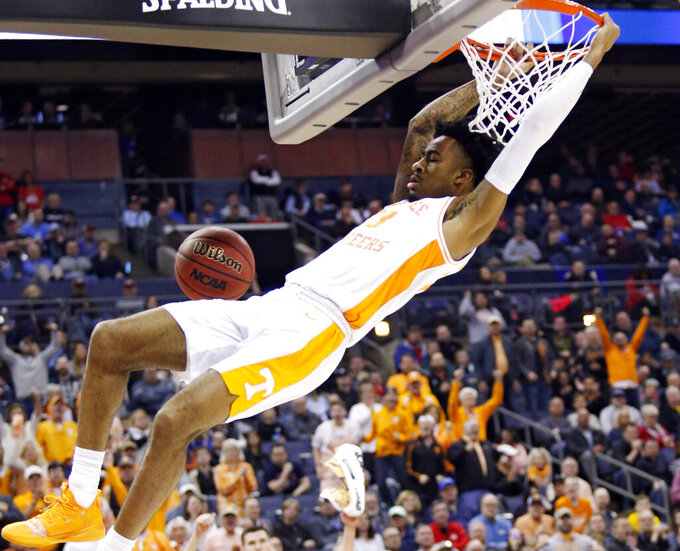 Tennessee's Jordan Bowden dunks the ball against Colgate in the second half of a first-round game in the NCAA men's college basketball tournament in Columbus, Ohio, Friday, March 22, 2019. Tennessee won 77-70. (AP Photo/Paul Vernon)