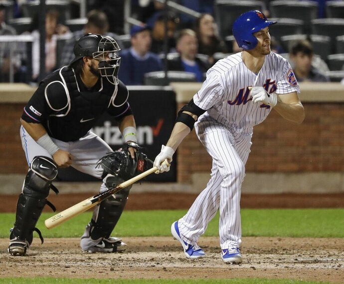 New York Mets' Jacob deGrom follows through on a RBI single during the sixth inning of the team's baseball game against the Miami Marlins Saturday, May 11, 2019, in New York. (AP Photo/Frank Franklin II)