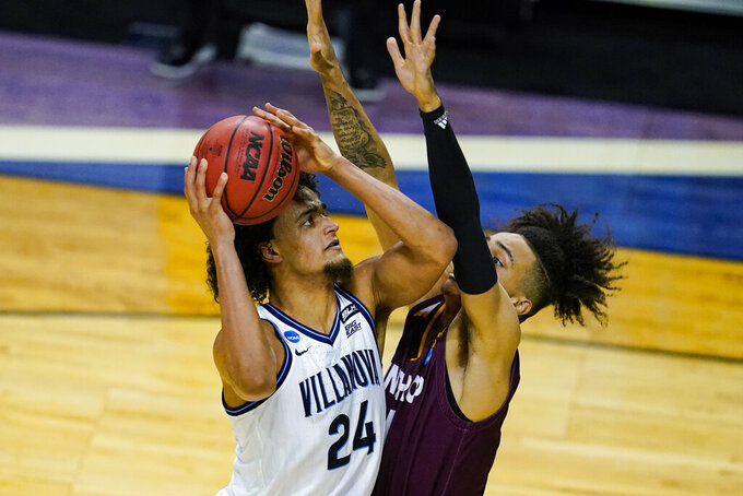 Villanova forward Jeremiah Robinson-Earl (24) shoots over Winthrop forward Kelton Talford (4) in the first half of a first round game in the NCAA men's college basketball tournament at Farmers Coliseum in Indianapolis, Friday, March 19, 2021. (AP Photo/Michael Conroy)
