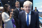 Boris Johnson walks to the stage, as rival Jeremy Hunt looks on after the announcement of the result in the ballot for the new Conservative party leader, in London, Tuesday, July 23, 2019. Brexit hardliner Boris Johnson won the contest to lead Britain's governing Conservative Party on Tuesday and will become the country's next prime minister, tasked with fulfilling his promise to lead the U.K. out of the European Union