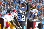 Carolina Panthers defensive tackle Vernon Butler (92) rushes Washington Redskins quarterback Dwayne Haskins (7) as offensive tackle Morgan Moses (76) blocks during the first half of an NFL football game in Charlotte, N.C., Sunday, Dec. 1, 2019. (AP Photo/Mike McCarn)