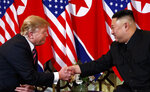 FILE - In this Wednesday, Feb. 27, 2019, file photo, U.S. President Donald Trump shakes hands with North Korean leader Kim Jong Un in Hanoi. Trump said he walked away from his second summit with North Korean leader Kim Jong Un because Kim demanded the U.S. lift all of its sanctions, a claim that North Korea's delegation called a rare news conference in the middle of the night to deny. (AP Photo/ Evan Vucci, File)