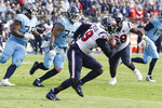 Houston Texans outside linebacker Whitney Mercilus (59) returns a pass interception 86 yards against the Tennessee Titans in the first half of an NFL football game Sunday, Dec. 15, 2019, in Nashville, Tenn. (AP Photo/James Kenney)