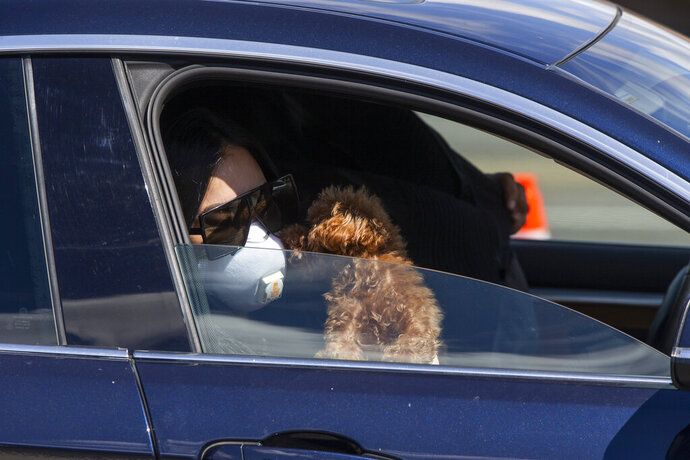 Aubrey Mondragon gets a kiss from her dog