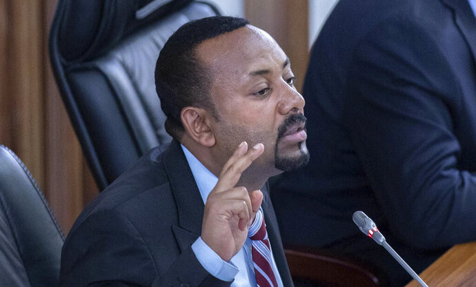 FILE - In this Tuesday, Oct. 22, 2019 file photo, Ethiopian Prime Minister Abiy Ahmed addresses members of parliament on the current situation in the country inside the Parliament buildings, in Addis Ababa, Ethiopia. Ethiopia's Nobel Peace Prize-winning prime minister urged calm on Wednesday, Nov. 20, 2019 as millions of citizens held a referendum on whether to create a new regional state along ethnic lines. (AP Photo/Mulugeta Ayene, File)