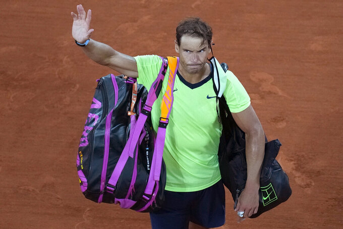 Spain's Rafael Nadal waves after losing to Serbia's Novak Djokovic during their semifinal match of the French Open tennis tournament at the Roland Garros stadium Friday, June 11, 2021 in Paris. Djokovic won 3-6, 6-3, 7-6 (4), 6-2. (AP Photo/Christophe Ena)