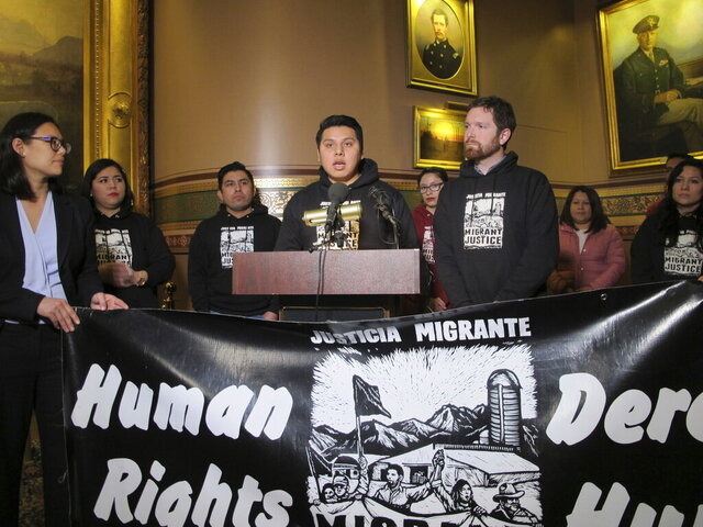 Enrique Balcazar of Migrant Justice speaks at a press conference in the Statehouse in Montpelier, Vt. on Wednesday, Jan. 15, 2020. The group announced a settlement of a lawsuit against the Department of Motor Vehicles, accusing the department of sharing information about immigrants with the federal government, leading to deportations. (AP Photo/Lisa Rathke)