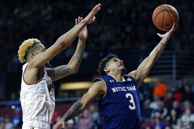 Notre Dame's Prentiss Hubb (3) shoots in front of Boston College's Ky Bowman during the second half of an NCAA college basketball game in Boston, Saturday, Feb. 2, 2019. (AP Photo/Michael Dwyer)