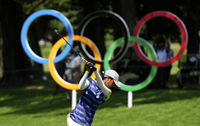 Aditi Ashok, of India, hits a tee shot on the 17th hole during the third round of the women's golf event at the 2020 Summer Olympics, Friday, Aug. 6, 2021, at the Kasumigaseki Country Club in Kawagoe, Japan. (AP Photo/Darron Cummings)