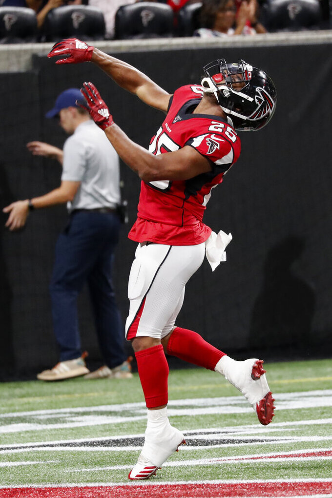 Atlanta Falcons running back Ito Smith (25) celebartes a touchdown against the New York Jets during the first half an NFL preseason football game, Thursday, Aug. 15, 2019, in Atlanta. (AP Photo/John Bazemore)