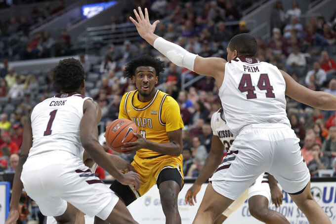 Valparaiso's Javon Freeman-Liberty, center, heads to the basket as Missouri State's Keandre Cook (1) and Gaige Prim (44) defend during the first half of an NCAA college basketball game in the semifinal round of the Missouri Valley Conference men's tournament Saturday, March 7, 2020, in St. Louis. (AP Photo/Jeff Roberson)
