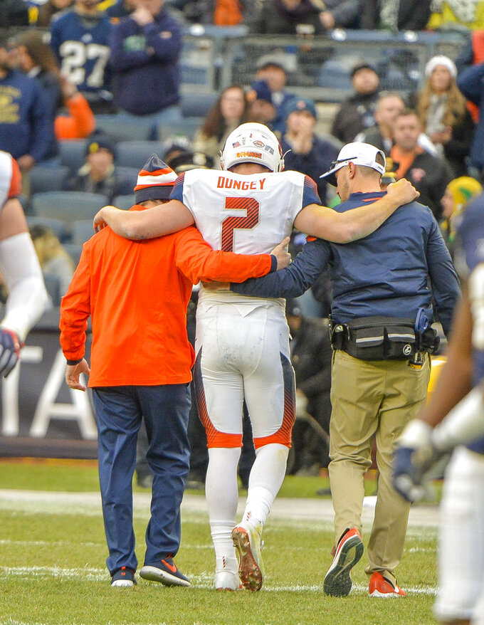 Syracuse quarterback Eric Dungey (2) is helped off the field after he was injured in the first half of an NCAA college football game against Notre Dame, Saturday, Nov. 17, 2018, at Yankee Stadium in New York. (AP Photo/Howard Simmons)