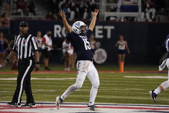 Northern Arizona quarterback RJ Martinez celebrates the team's 21-19 win over Arizona during an NCAA college football game Saturday, Sept. 18, 2021, in Tucson, Ariz. (AP Photo/Rick Scuteri)