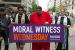 FILE - In this Wednesday, June 12, 2019 file photo, The Rev. Dr William Barber, center, accompanied by faith leaders, march to the White House in Washington protesting against President Donald Trump policies. The Disciples of Christ pastor from North Carolina, a long-time Black civil rights activist, has been outspoken in 2020 in demanding that systemic racism be addressed. (AP Photo/Jose Luis Magana)