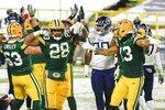Green Bay Packers' A.J. Dillon celebrates his touchdown run during the second half of an NFL football game against the Tennessee Titans Sunday, Dec. 27, 2020, in Green Bay, Wis. (AP Photo/Matt Ludtke)